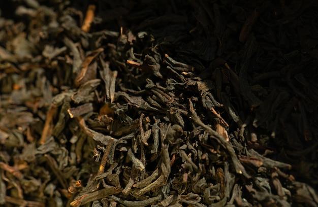 黒茶の背景。茶葉を乾燥させます。