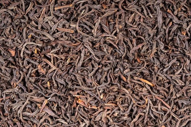 紅茶は背景を残します。抽象的な食感。クローズアップ、上面図