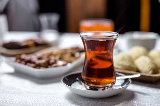 Black tea in national armudy glass side view
