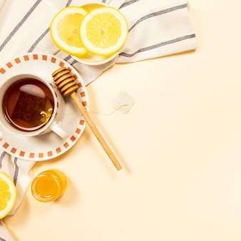 Black tea with honey and fresh lemon slice