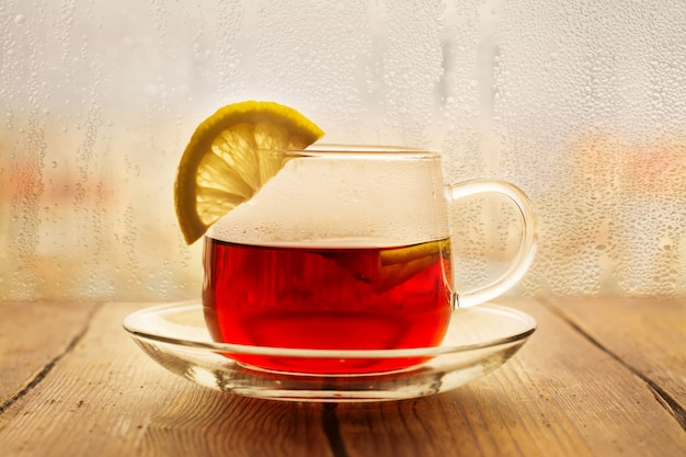 Black tea with lemon slices in a glass cup