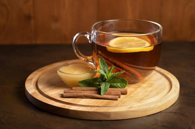Black tea with lemon in a transparent cup