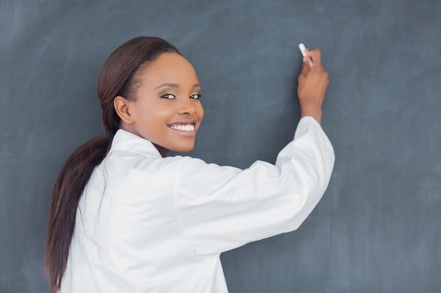 Black teacher holding a chalk