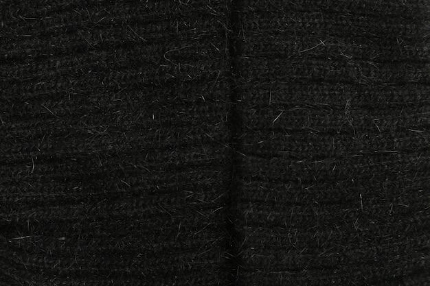 黒のテクスチャウールのクローズアップ、織布、ニット生地
