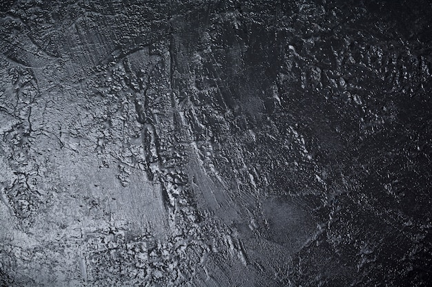 Black textured stone surface with place for text