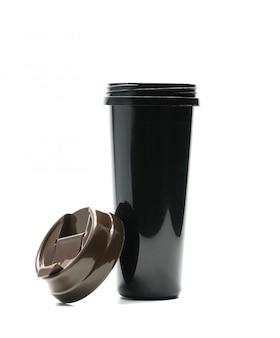 白い背景に分離された蓋が開いている黒い魔法瓶、ちょうどあなた自身のテキストを追加