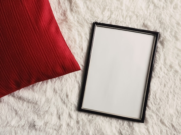 Black thin wooden frame with blank copyspace as poster photo print mockup