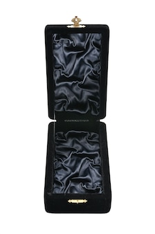 Black velvet jewelry box on an isolated white surface