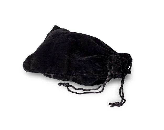 白い背景の上の黒いベルベットのポーチ。