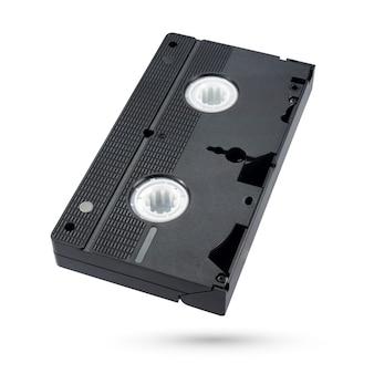 白い背景で隔離の黒いvhsビデオテープカセット。背面図