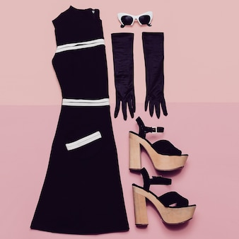 Black vintage dress and accessories. mademoiselle style. gloves, glasses, heel. retro glam top view