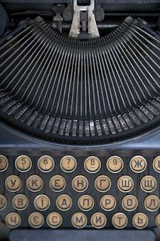 Black vintage typewriter closeup mechanism.