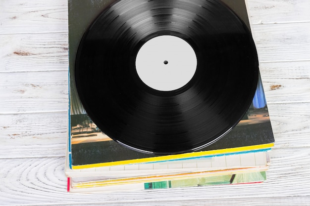 Black vinyl records on the wooden table