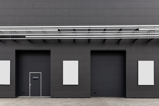 Black wall of the building with doors, emergency exits