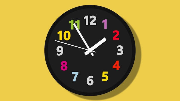 Black wall clock with colorful numbers on yellow background