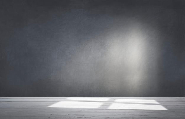Черная стена в пустой комнате с бетонным полом
