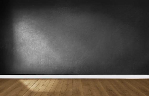 木製の床と空の部屋で黒い壁