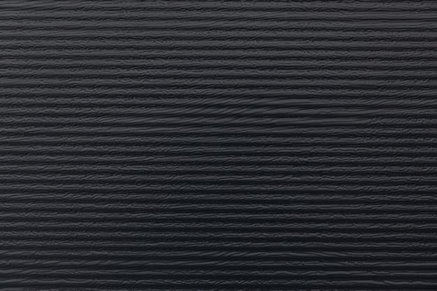 Черная стена здания. полосы текстуры