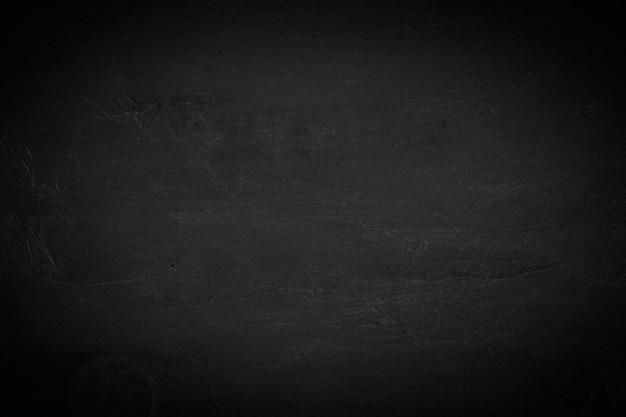 黒い壁のテクスチャの粗い背景が暗い。黒とグランジの背景。ビネット。