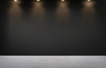 Black wall with a row of spotlights in an empty room