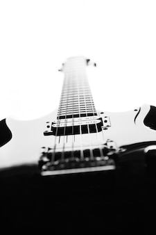 Black and white abstract silhouette of a guitar on a white background.