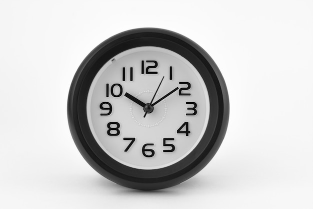 Black and white alarm clock on white background.