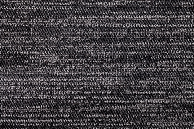 Black and white background from soft textile material. fabric with natural texture.