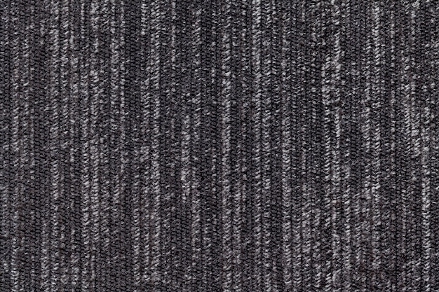 Black and white background of a knitted textile material. fabric with a striped texture closeup.