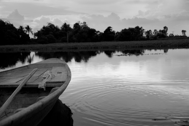 Black and white boat in a pond.