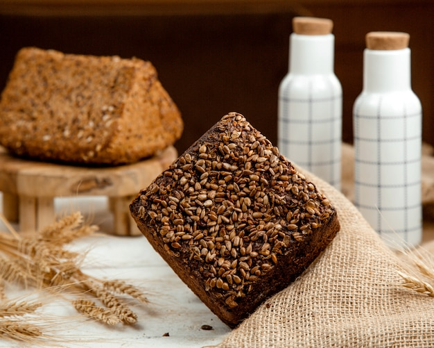 Black and white bread with sesame _