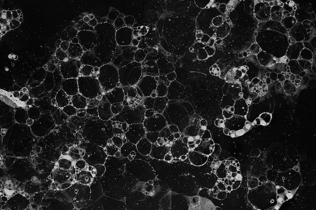 Black and white bubble art black background monotone style