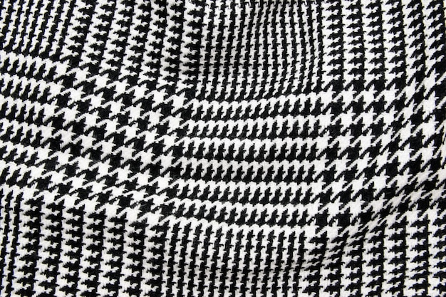 Black and white cage fabric or cloth textile.