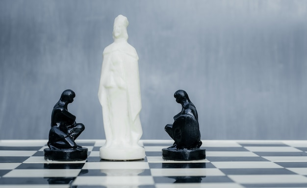 Black and white chess pieces on the chessboard.