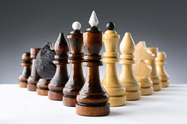 Black and white chess pieces on a table