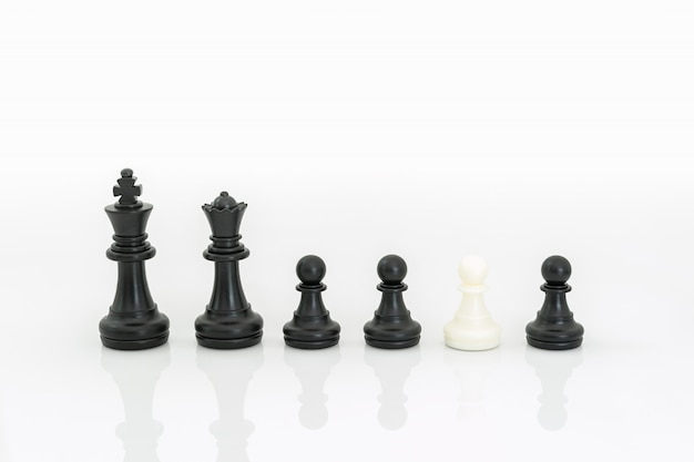 Black and white chess pieces on white background
