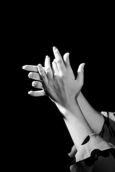 Black and white clapping hands