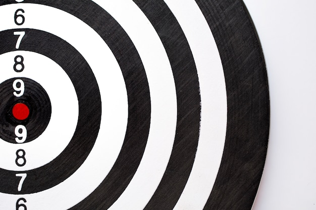 Black and white dartboard texture with punctuation numbers.