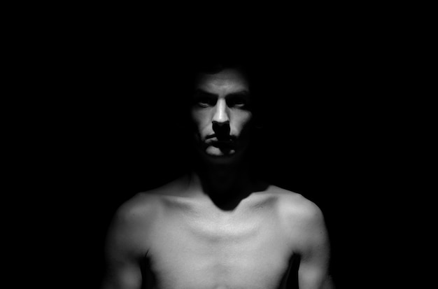 Black and white dramatic photo of a man