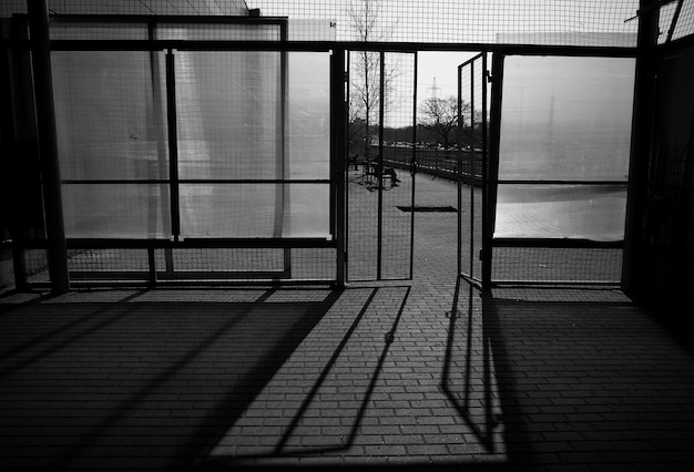 Black and white entrance with light rays city background