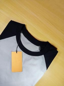 Black white folded raglan t-shirt with tag price