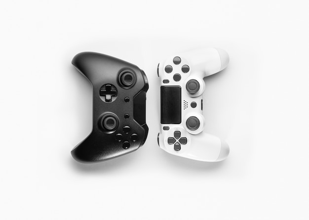 Black and white game controllers on white space
