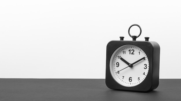 Black and white image of a clock on a black and white background.
