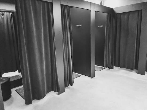 Black and white image of dressing room in shopping mall