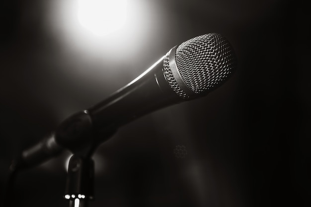 Black and white image of the microphone. the microphone on the stage is close-up. a pub. bar. a restaurant. classical music. music