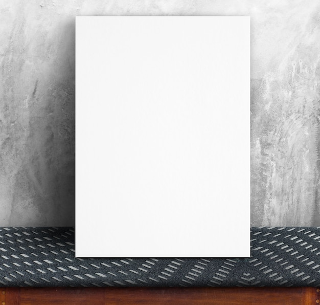 Black white paper poster lean at concrete wall and fabric table,template mock up for adding your text