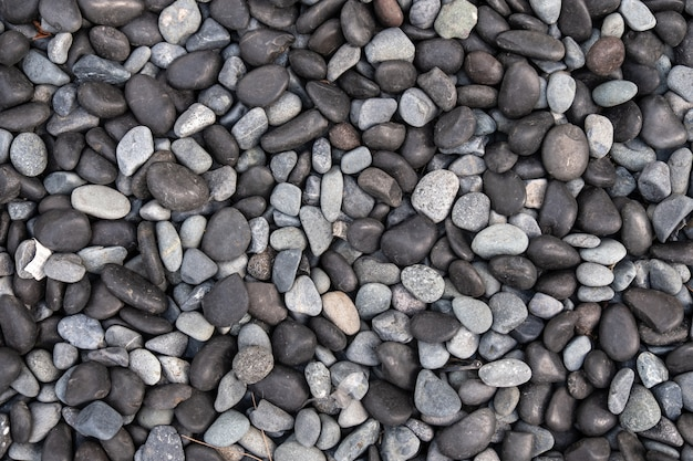 Black and white pebbles for background and texture. rock or stone pebble is sign of spa and zen religion.