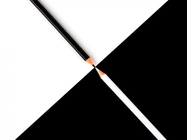 Black and white pencils on a contrasting background