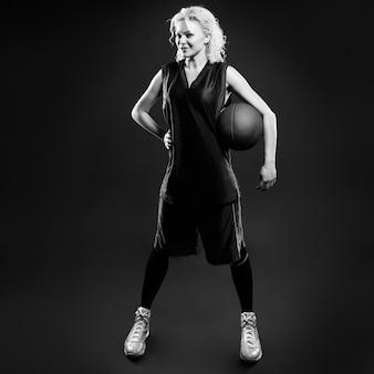 Black and white phoro of female basketballer