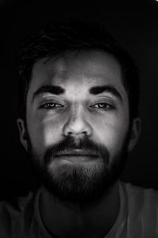 Black and white photo of bearded man