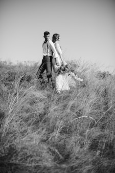 Black and white photo. bride and groom at the wedding in nature.